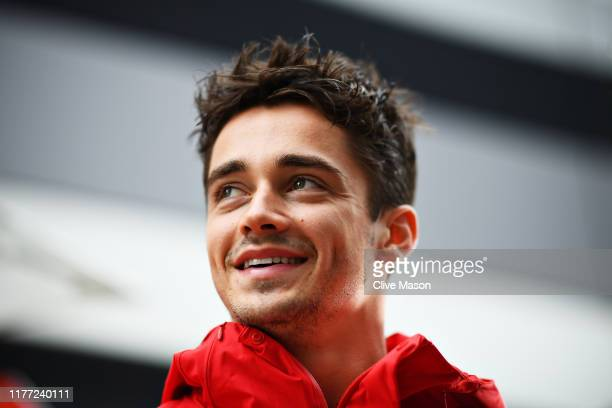 Charles Leclerc of Monaco and Ferrari talks to the media in the Paddock during previews ahead of the F1 Grand Prix of Russia at Sochi Autodrom on...