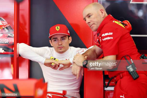 Charles Leclerc of Monaco and Ferrari talks with Jock Clear, Head of Engineering, Scuderia Ferrari in the garage during practice for the F1 Grand...