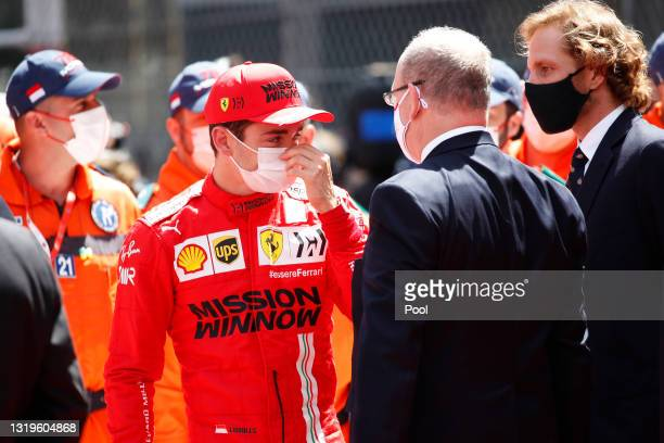 Charles Leclerc of Monaco and Ferrari talks with Prince Albert of Monaco after discovering that he could not start the race during the F1 Grand Prix...