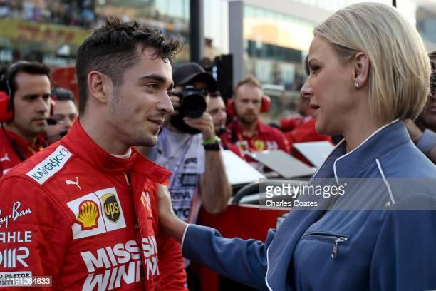 Charles Leclerc of Monaco and Ferrari talks with Princess Charlene of Monaco on the grid before the F1 Grand Prix of Abu Dhabi at Yas Marina Circuit...