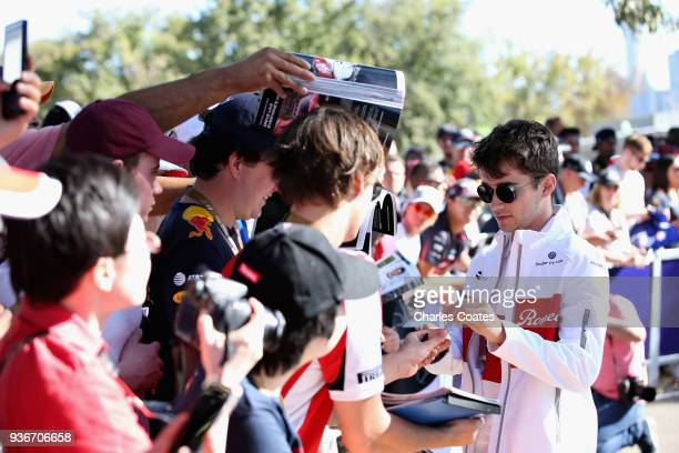 Charles Leclerc of Monaco and Sauber F1 arrives at the circuit and signs autographs for fans before practice for the Australian Formula One Grand...
