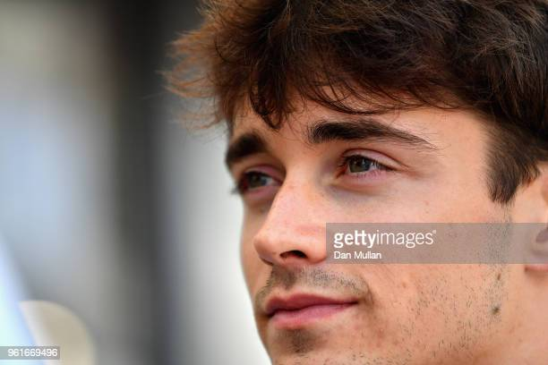 Charles Leclerc of Monaco and Sauber F1 looks on in the Paddock during previews ahead of the Monaco Formula One Grand Prix at Circuit de Monaco on...