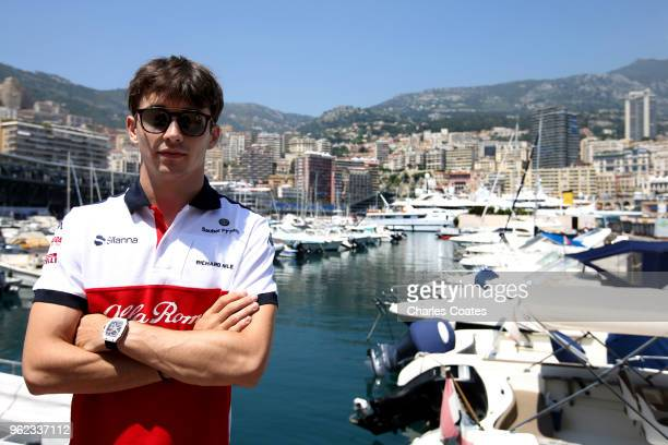 Charles Leclerc of Monaco and Sauber F1 poses for a photo in front of the harbour during previews ahead of the Monaco Formula One Grand Prix at...