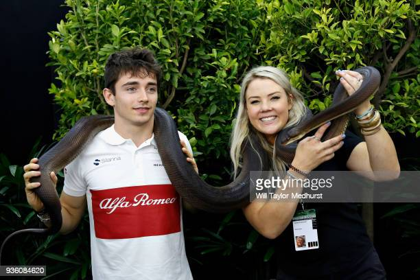 Charles Leclerc of Monaco and Sauber F1 poses for a photo with a snake during previews ahead of the Australian Formula One Grand Prix at Albert Park...