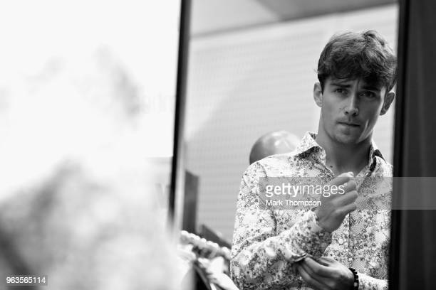 Charles Leclerc of Monaco and Sauber F1 prepares backstage at the Amber Lounge Fashion show during previews ahead of the Monaco Formula One Grand...