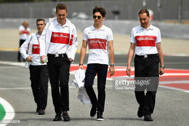 Charles Leclerc of Monaco and Sauber F1 walks the track with his engineers during previews ahead of the Spanish Formula One Grand Prix at Circuit de...