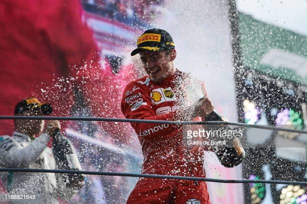 Charles Leclerc of Monaco and Scuderia Ferrari celebrates on the podium after winning the Formula 1 Grand Prix of Italy at Autodromo di Monza on...