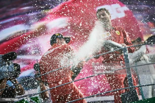 Charles Leclerc of Monaco and Scuderia Ferrari celebrates on the podium after winning the Formula 1 Grand Prix of Italy at Autodromo di Monza on...
