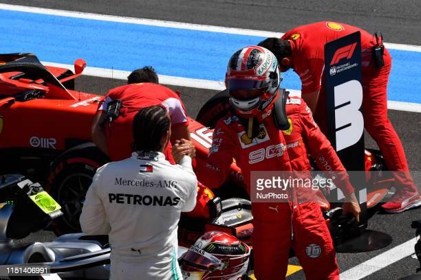 Charles Leclerc of Monaco and Scuderia Ferrari Mission Winnow SF90 and Lewis Hamilton of Great Britain and Mercedes AMG Petronas F1 Team Mercedes...