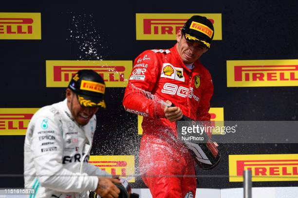 Charles Leclerc of Monaco and Scuderia Ferrari Mission Winnow third position and Lewis Hamilton of Great Britain and Mercedes AMG Petronas F1 Team...