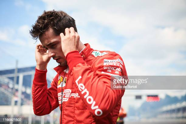 Charles Leclerc of Monaco and Scuderia Ferrari prepares on the grid before the start of the Formula 1 Grand Prix of Italy at Autodromo di Monza on...