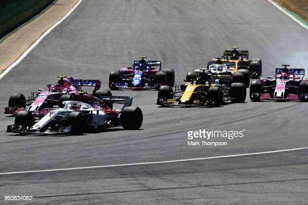Charles Leclerc of Monaco driving the Alfa Romeo Sauber F1 Team C37 Ferrari leads Esteban Ocon of France driving the Sahara Force India F1 Team VJM11...