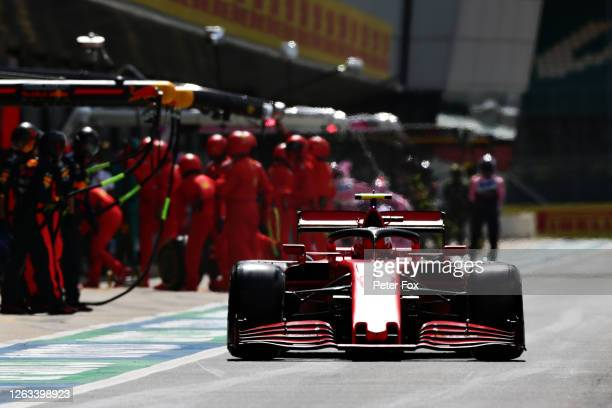 Charles Leclerc of Monaco driving the Scuderia Ferrari SF1000 makes a pitstop for new tyres during the F1 Grand Prix of Great Britain at Silverstone...