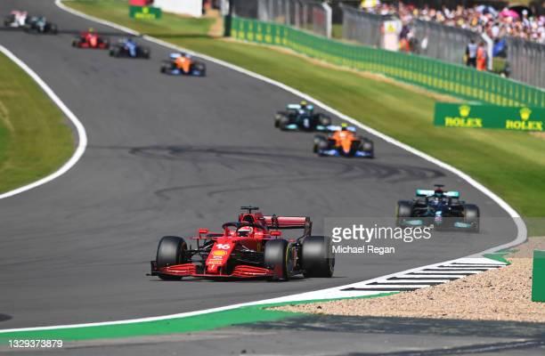 Charles Leclerc of Monaco driving the Scuderia Ferrari SF21 leads Lewis Hamilton of Great Britain driving the Mercedes AMG Petronas F1 Team Mercedes...