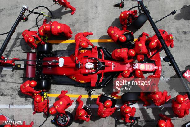 Charles Leclerc of Monaco driving the Scuderia Ferrari SF21 makes a pitstop during the F1 Grand Prix of Styria at Red Bull Ring on June 27, 2021 in...