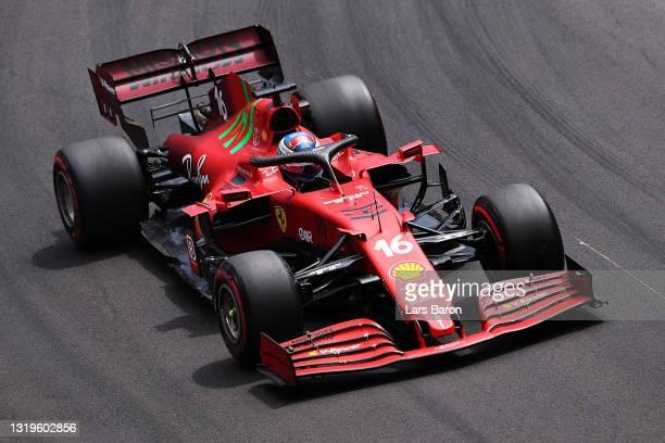 Charles Leclerc of Monaco driving the Scuderia Ferrari SF21 on his way to the grid ahead of the F1 Grand Prix of Monaco at Circuit de Monaco on May...