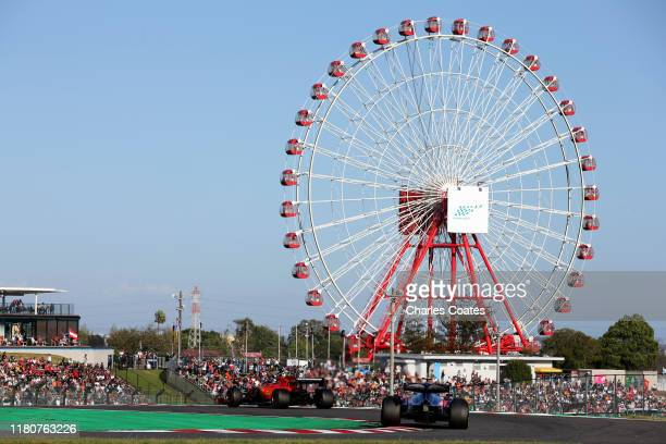 Charles Leclerc of Monaco driving the Scuderia Ferrari SF90 and Pierre Gasly of France driving the Scuderia Toro Rosso STR14 Honda on track during...