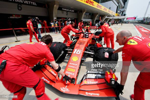 Charles Leclerc of Monaco driving the Scuderia Ferrari SF90 is pushed back into the garage during practice for the F1 Grand Prix of China at Shanghai...