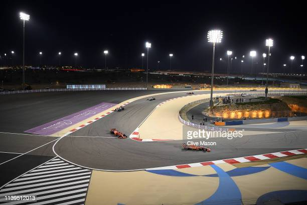 Charles Leclerc of Monaco driving the Scuderia Ferrari SF90 leads Sebastian Vettel of Germany driving the Scuderia Ferrari SF90, Lewis Hamilton of...