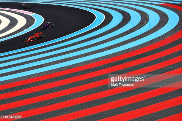 Charles Leclerc of Monaco driving the Scuderia Ferrari SF90 leads Daniil Kvyat driving the Scuderia Toro Rosso STR14 Honda and Romain Grosjean of...