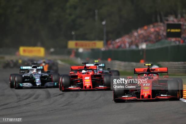 Charles Leclerc of Monaco driving the Scuderia Ferrari SF90 leads Sebastian Vettel of Germany driving the Scuderia Ferrari SF90 on track during the...