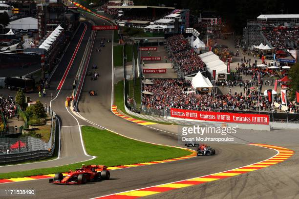 Charles Leclerc of Monaco driving the Scuderia Ferrari SF90 leads Lewis Hamilton of Great Britain driving the Mercedes AMG Petronas F1 Team Mercedes...