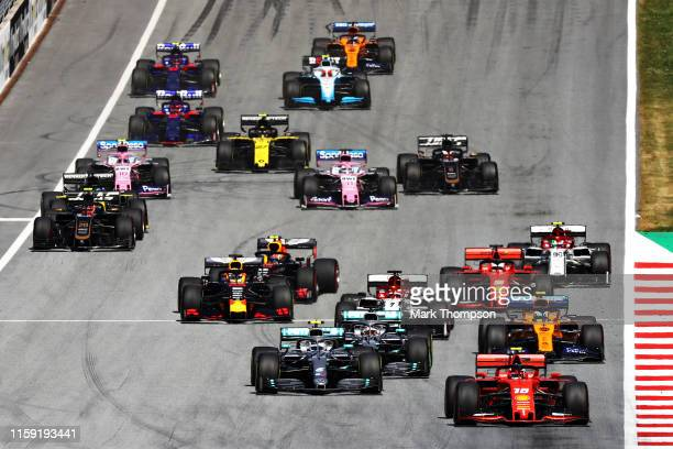 Charles Leclerc of Monaco driving the Scuderia Ferrari SF90 leads the field at the start during the F1 Grand Prix of Austria at Red Bull Ring on June...