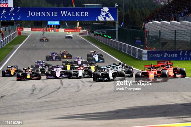 Charles Leclerc of Monaco driving the Scuderia Ferrari SF90 leads the field into turn one at the start during the F1 Grand Prix of Belgium at Circuit...