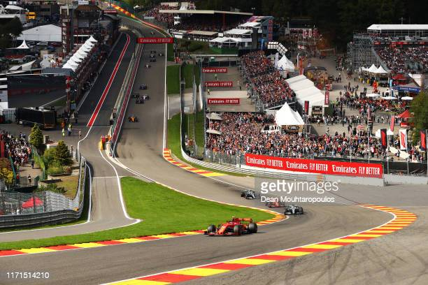 Charles Leclerc of Monaco driving the Scuderia Ferrari SF90 leads the field into up Eau Rouge at the start during the F1 Grand Prix of Belgium at...