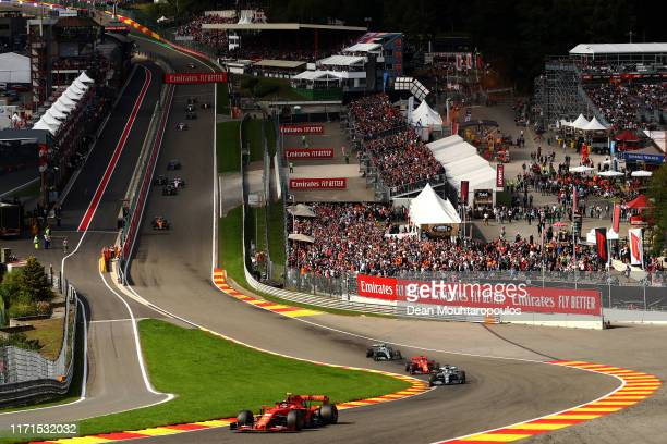 Charles Leclerc of Monaco driving the Scuderia Ferrari SF90 leads the field up Eau Rouge - Raidillon at the start during the F1 Grand Prix of Belgium...