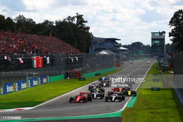 Charles Leclerc of Monaco driving the Scuderia Ferrari SF90 leads the field at the start during the F1 Grand Prix of Italy at Autodromo di Monza on...