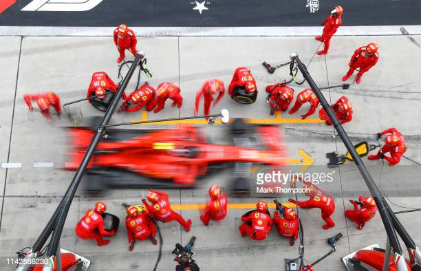 Charles Leclerc of Monaco driving the Scuderia Ferrari SF90 makes a pitstop for new tyres during the F1 Grand Prix of China at Shanghai International...