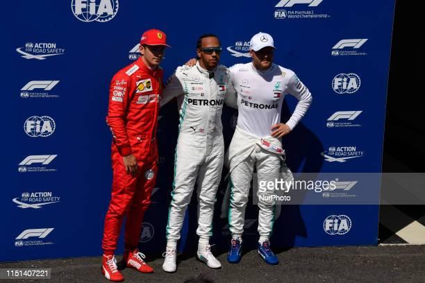 Charles Leclerc of Monaco Scuderia Ferrari Mission Winnow and Lewis Hamilton of Great Britain and Valtteri Bottas of Finland driving of MercedesAMG...