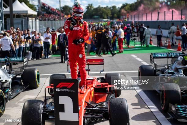 Charles Leclerc of Scuderia Ferrari celebrates in parc ferme after the F1 Grand Prix of Italy