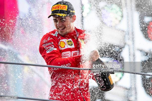 Charles Leclerc of Scuderia Ferrari celebrates on the podium after the Formula One Grand Prix of Italy.