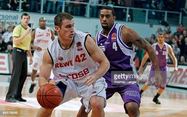 Charles Lee of Goettingen and Wyrick Beckham of Bamberg battle for the ball during the Basketball Bundesliga match between Brose Baskets Bamberg and...
