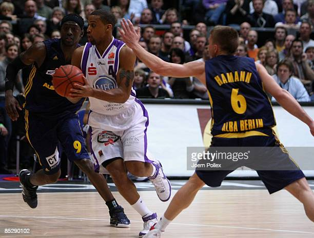 Charles Lee of Goettingen in action against Ansu Sesay and Steffen Hamann of Berlin during the Basketball Bundesliga match between MEG Goettingen and...