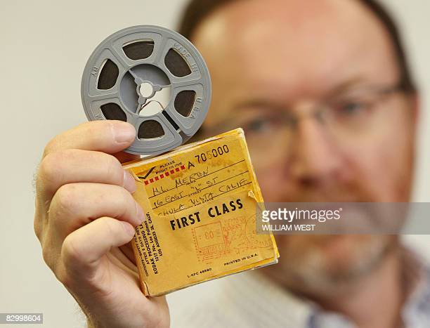 Charles Leski holds up a two minute amateur film of screen goddess Marilyn Monroe which has surfaced almost 50 years after it was presumed lost and...