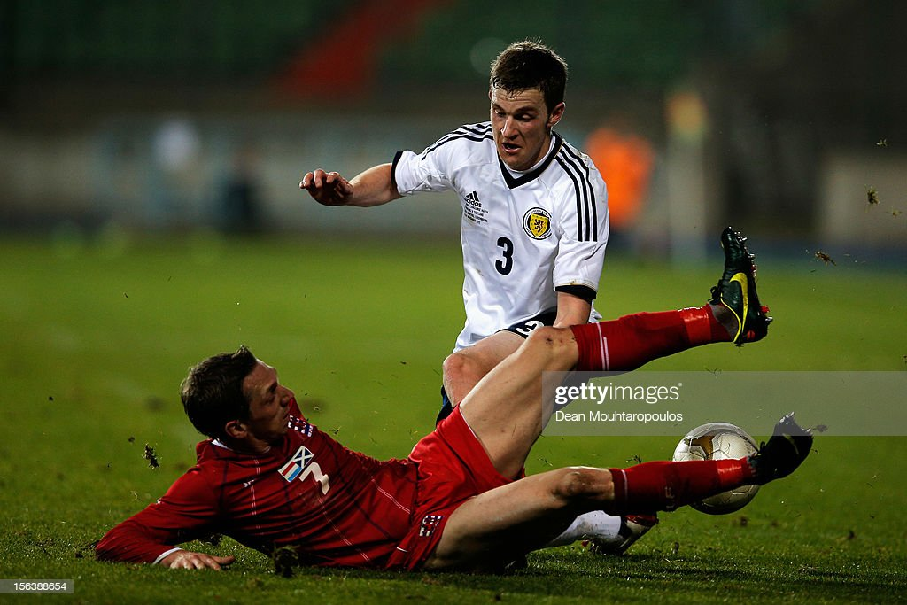 Charles Leweck of Luxembourg tackles Steven Whittaker of Scotland during the International Friendly match between Luxembourg and Scotland at Stade Josy Barthel on November 14, 2012 in Luxembourg, Luxembourg.