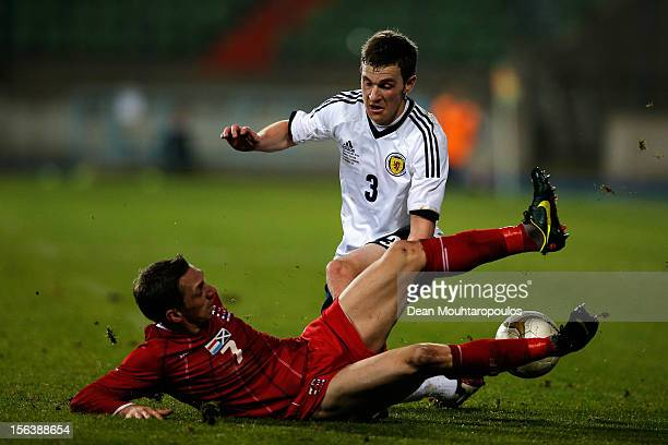 Charles Leweck of Luxembourg tackles Steven Whittaker of Scotland during the International Friendly match between Luxembourg and Scotland at Stade...