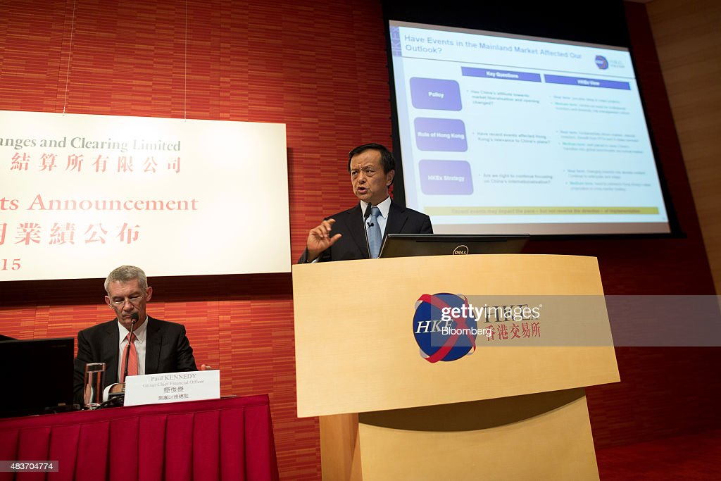 Charles Li, chief executive officer of Hong Kong Exchanges & Clearing Ltd. (HKEx), right, gestures as he speaks during a news conference while Paul Kennedy, chief financial officer of HKEx, listens, in Hong Kong, China, on Wednesday, Aug. 12, 2015. Hong Kong Exchanges headed for its steepest slide in two weeks after the bourse operator's profit missed estimates. Photographer: Jerome Favre/Bloomberg via Getty Images