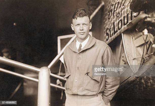 Charles Lindbergh , American aviator. He is seen here posing by the plane in which he completed the first nonstop solo flight across the Atlantic,...
