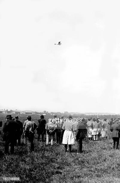 Charles Lindbergh American aviator piloting his biplane the Spirit of St Louis at Le Bourget airport in front of spectators just after his nonstop...