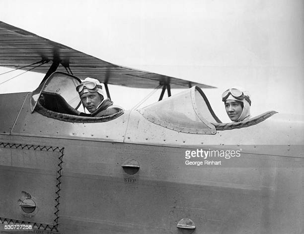 Charles Lindbergh and Bride in Cockpit of airplane.