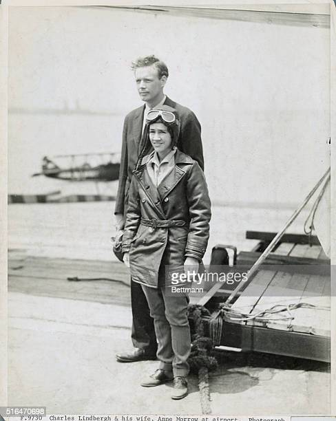 Charles Lindbergh and his wife, Anne Morrow, at airport.
