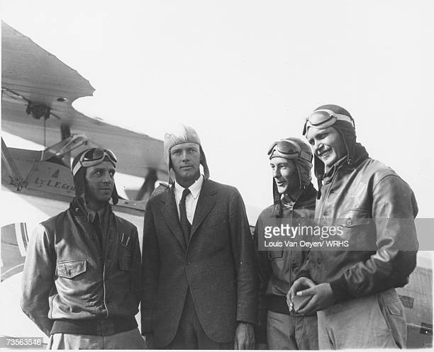 Charles Lindbergh at the Cleveland Municipal Airport with three members of the Navy High Hats. Lindbergh and the precision flying team which...