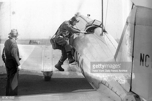Charles Lindbergh boarding his plane.