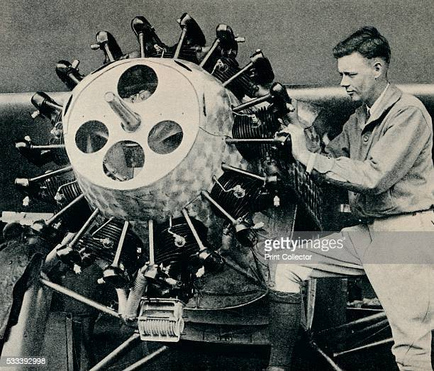 Charles Lindbergh checking the 220 hp Wright Whirlwind engine of his aircraft before his transatlantic flight' from 'Wonders of World Aviation Vol 1'...