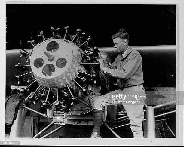 Charles Lindbergh examines the engine cylinders on the Spirit of St. Louis.