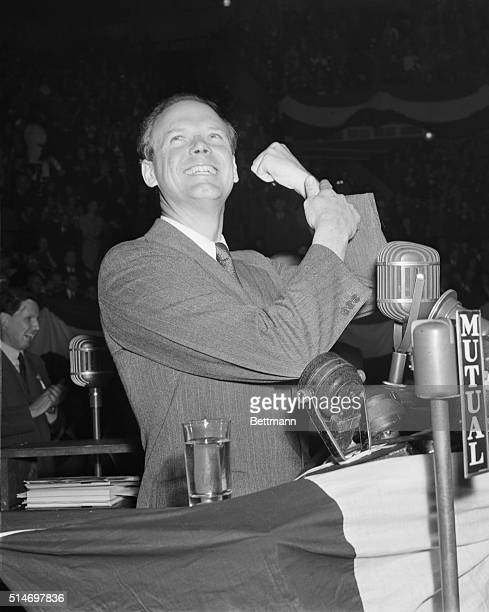 Charles Lindbergh greets the crowd with a triumphant gesture at an America First rally at Madison Square Garden in Manhattan.